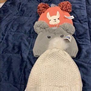 Three babies hats